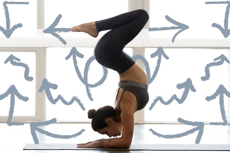 Young woman striking yoga pose